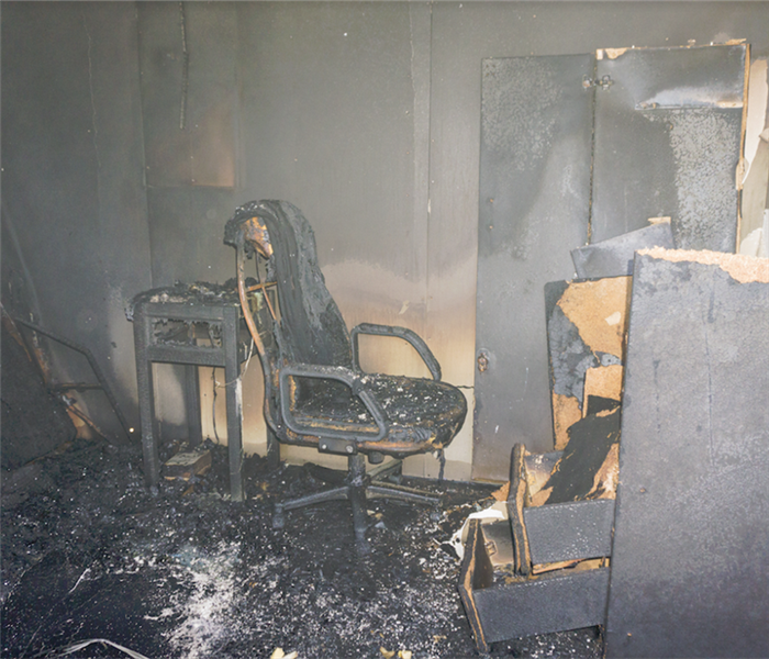 a fire damaged room with soot covering everything