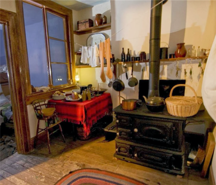 inside a tenement, wood burning stove