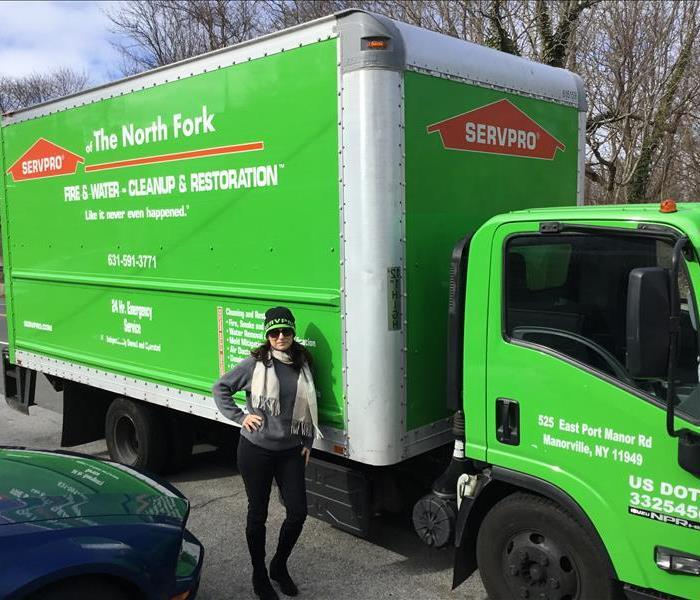 SERVPRO box truck with a posing female employee