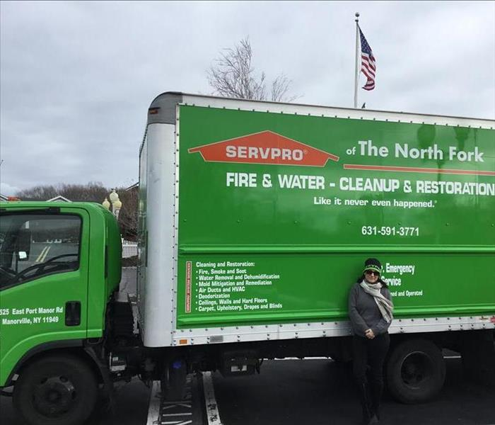 SERVPRO Green Vehicles Parked and on the Job